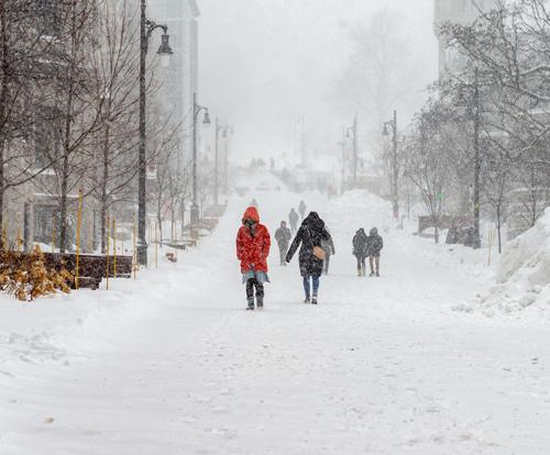 People Walking in Snowy Street