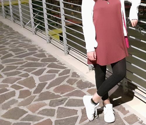 Woman Wearing Dress with Leggings