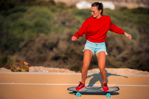 woman wearing jean shorts and hoodie