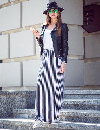 Woman Wearing a Maxi Skirt and Sneakers